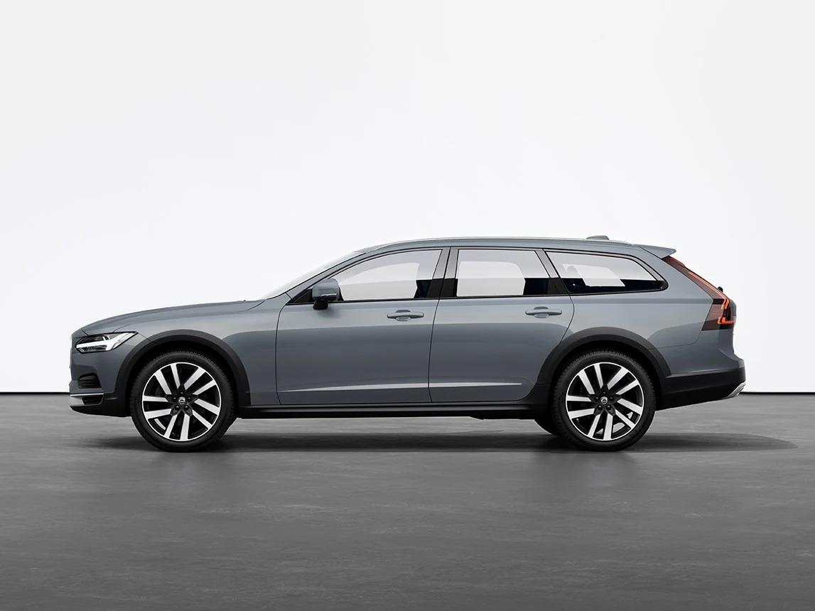 머슬 블루 메탈릭 Volvo V90 Cross Country Estate가 스튜디오의 회색 바닥에 세워져 있습니다