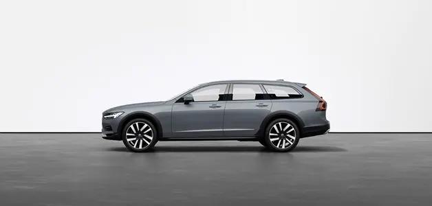 머슬 블루 Volvo V90 Cross Country Estate가 스튜디오의 회색 바닥에 세워져 있습니다